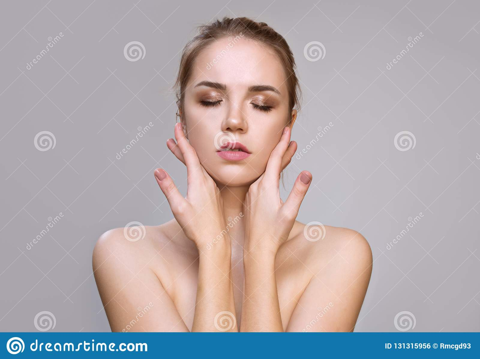 Beautiful Young Woman with Clean Fresh Skin . Facial treatment