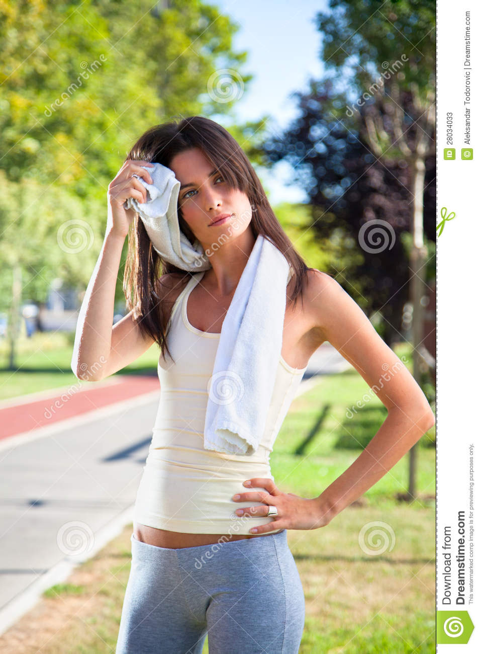 Beautiful young woman cleaning her sweat with a towel