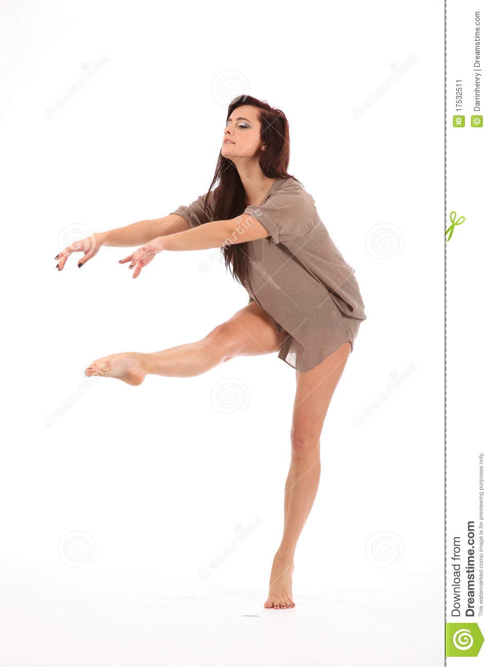 Female dancer with one leg raised toe pointed demonstrating dance