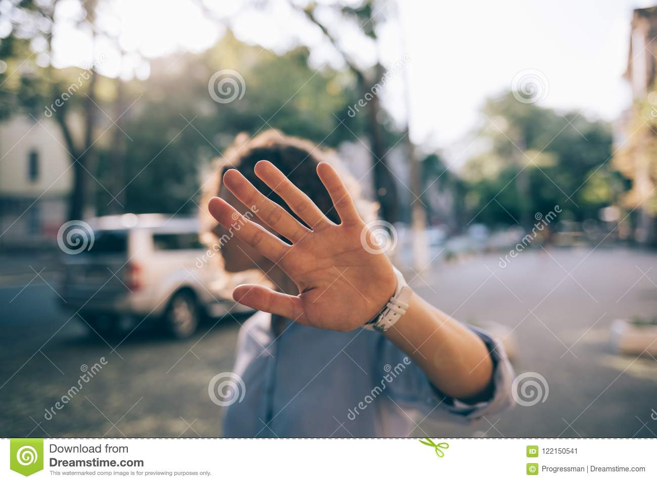 Beautiful young woman covering face with her palm
