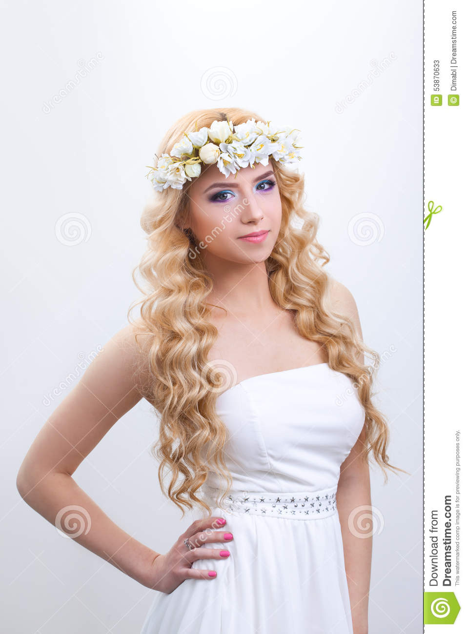 Beautiful young woman with delicate flowers in