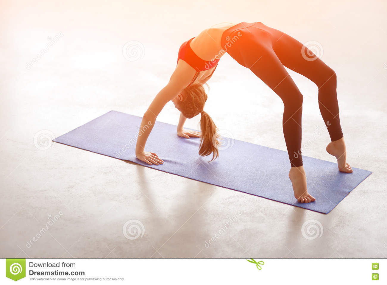 Beautiful Young Woman Doing Yoga Exercise Bridge Pose
