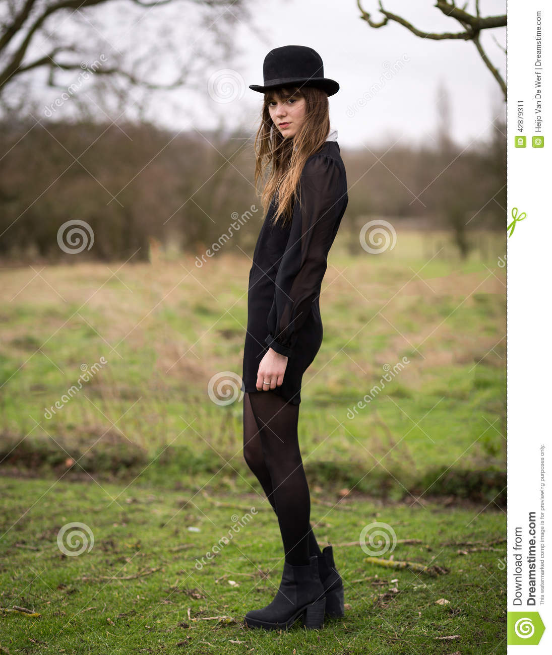 Original Beautiful Equestrian Woman Wearing Riding Boots And Plaid Poncho Stock Photo | Getty Images