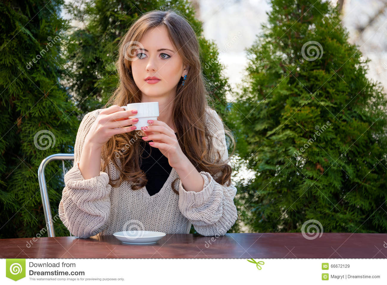 Hot woman drinking morning coffee