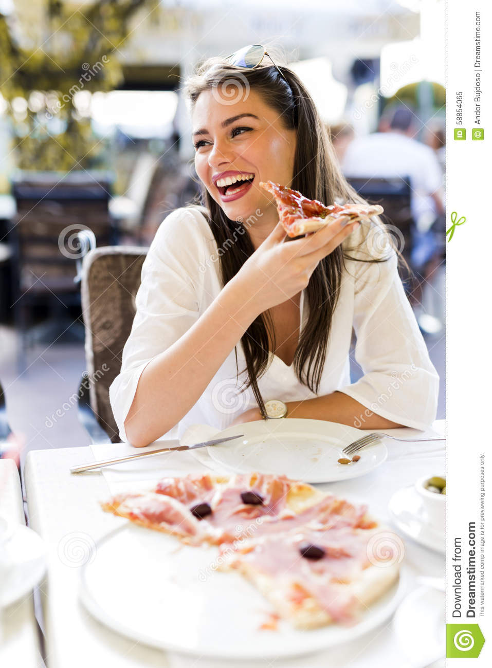 Beautiful Eat In Kitchens: Beautiful Young Woman Eating A Slice Of Pizza In A