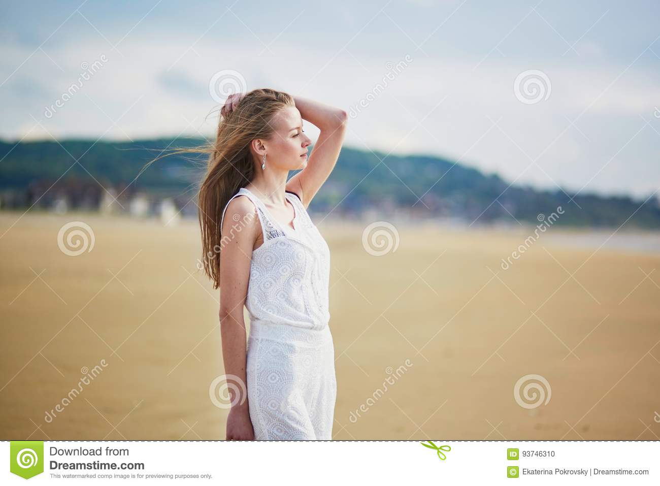 Girl Sitting On Sand Of Beach Stock Photo   Getty Images