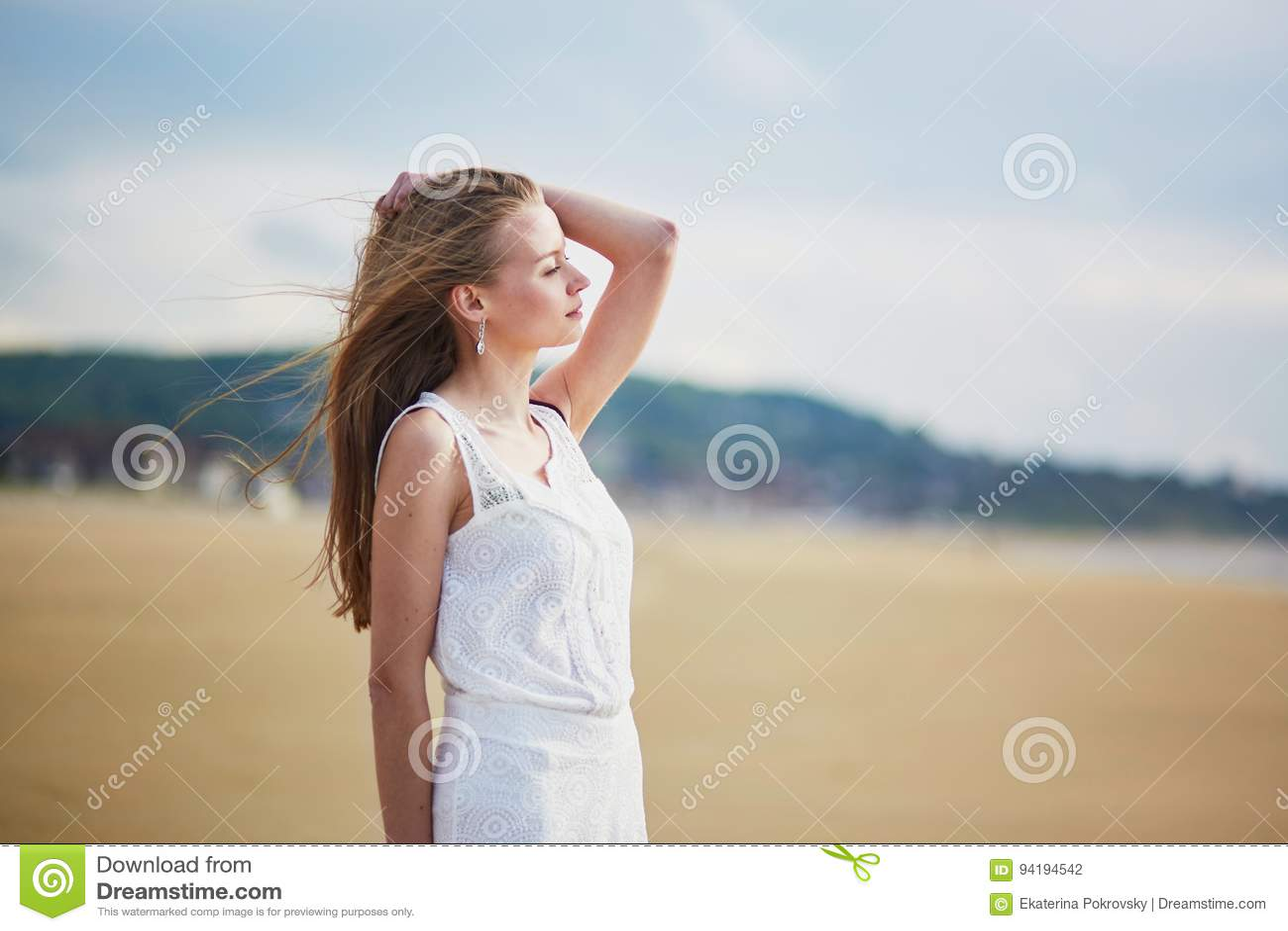 Beautiful Curvy Young Woman Enjoying Ocean At The Beach