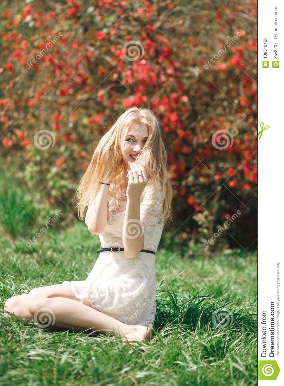 Beautiful young woman enjoying sunny day in park during blossom season on a  nice spring day. 88505cebf