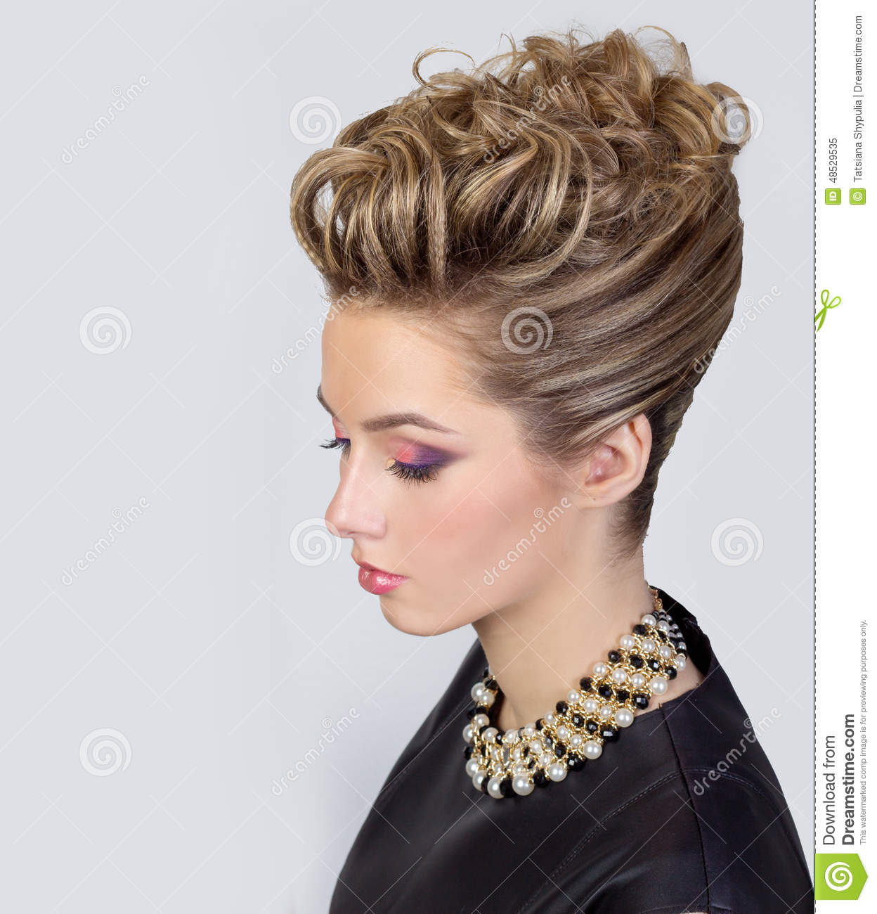 Beautiful Young Woman With Evening Make Up And Salon Hairdo Smoky