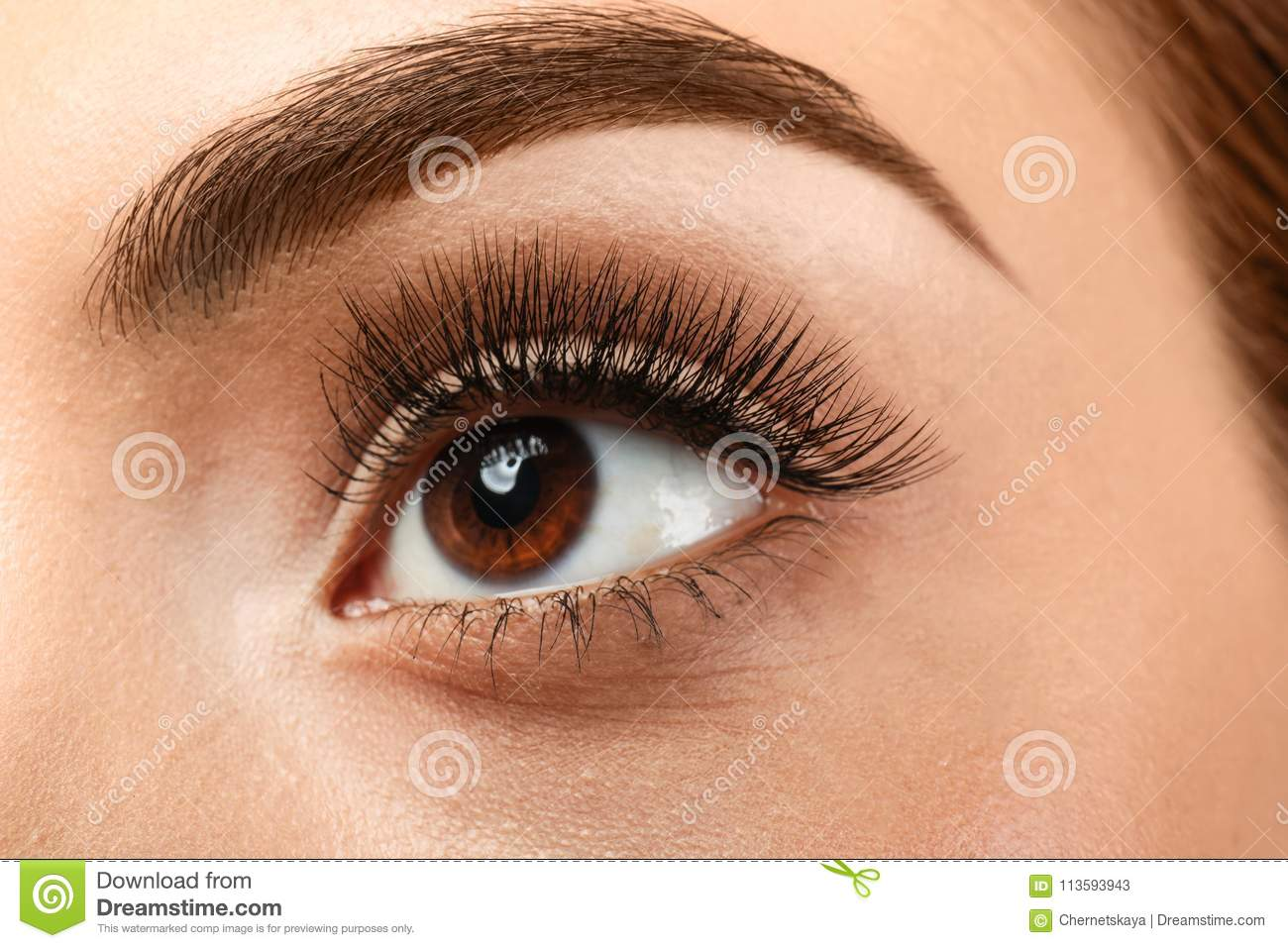 Beautiful young woman with eyelash extensions,