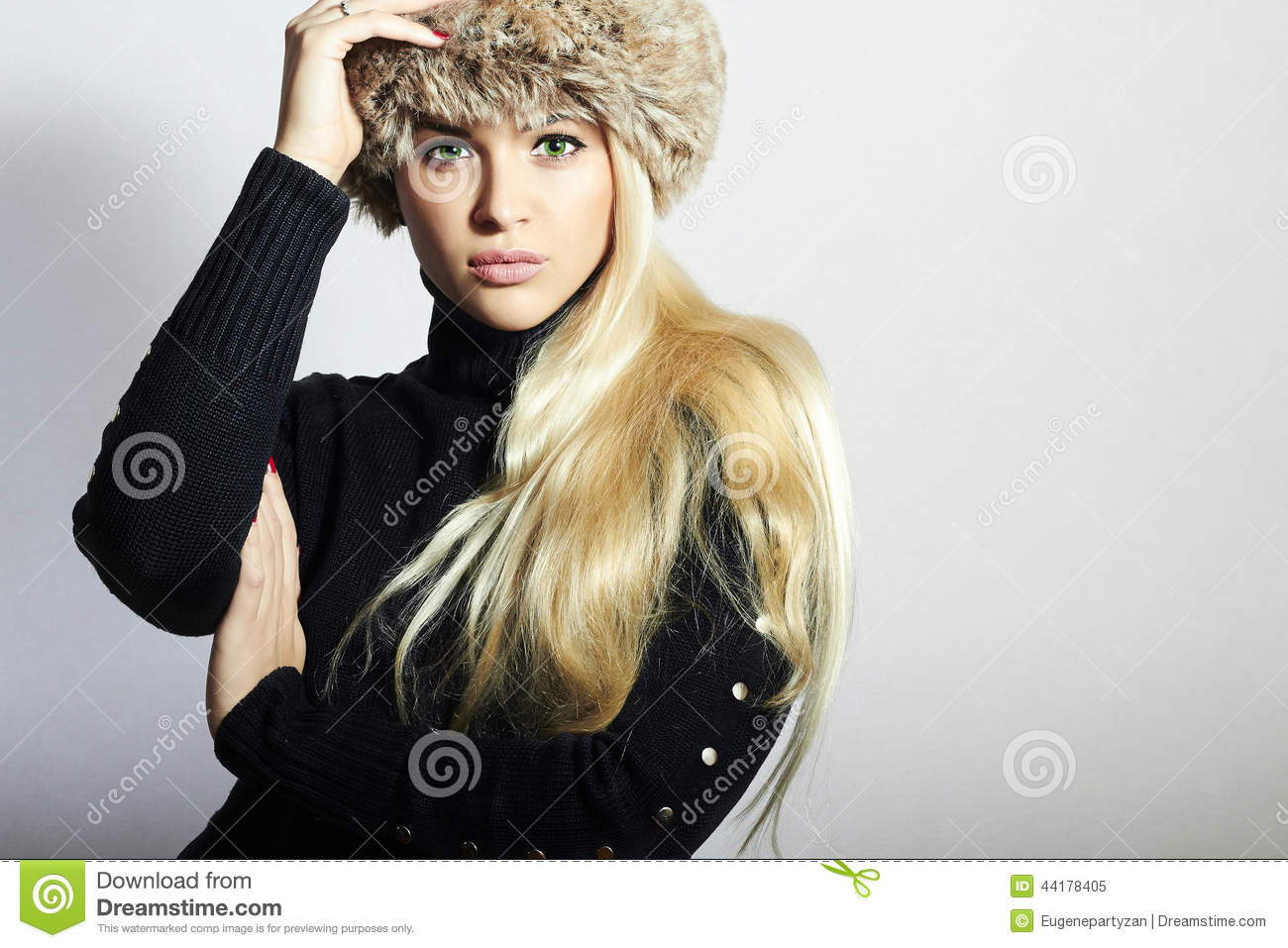 Beautiful Young Woman In Fur Hat. Pretty Blond Girl