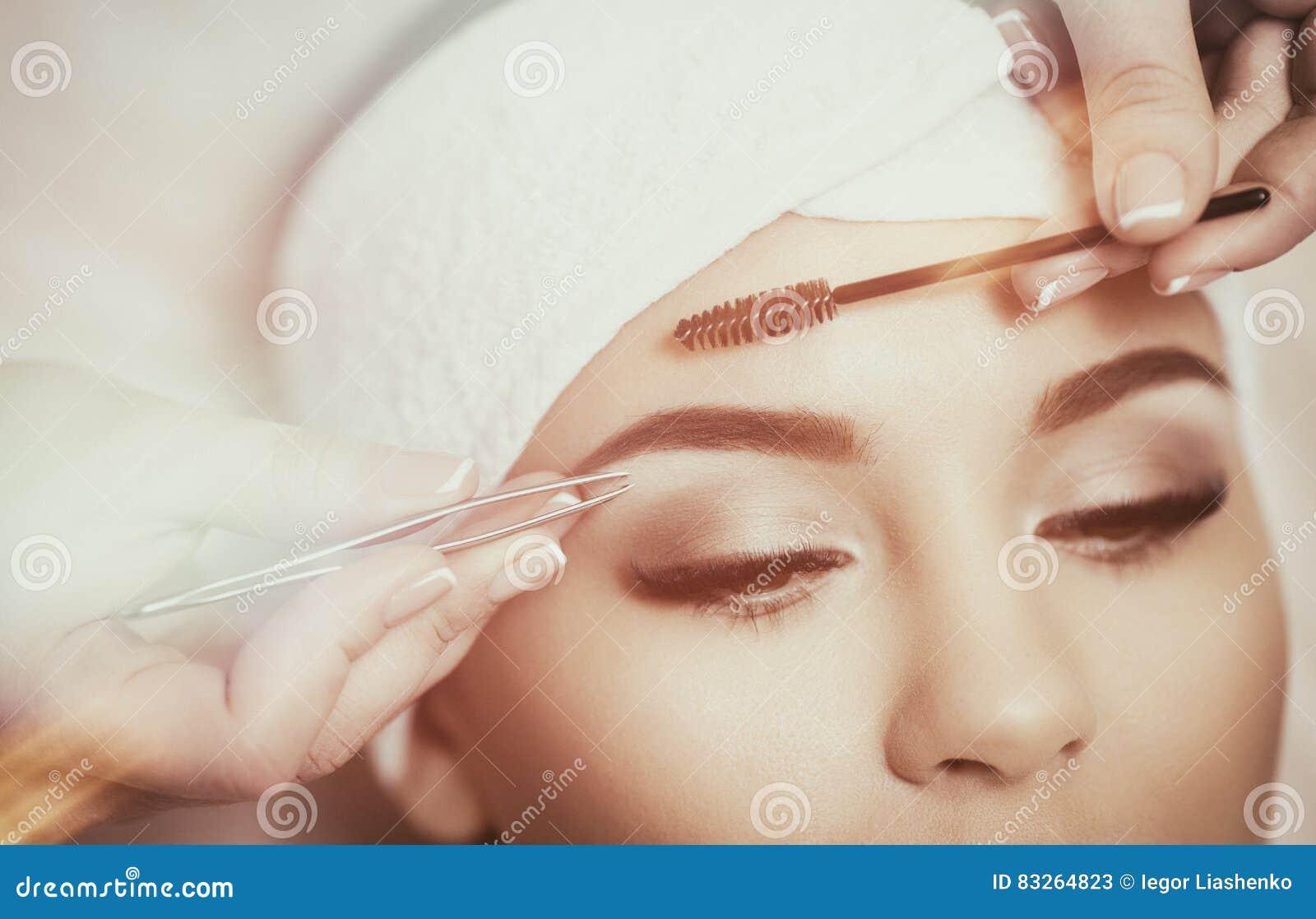 Beautiful Young Woman Gets Eyebrow Correction Procedure Stock Image