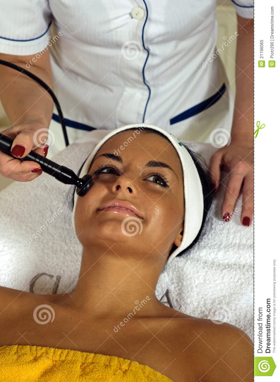 Beautiful young woman getting face massage.