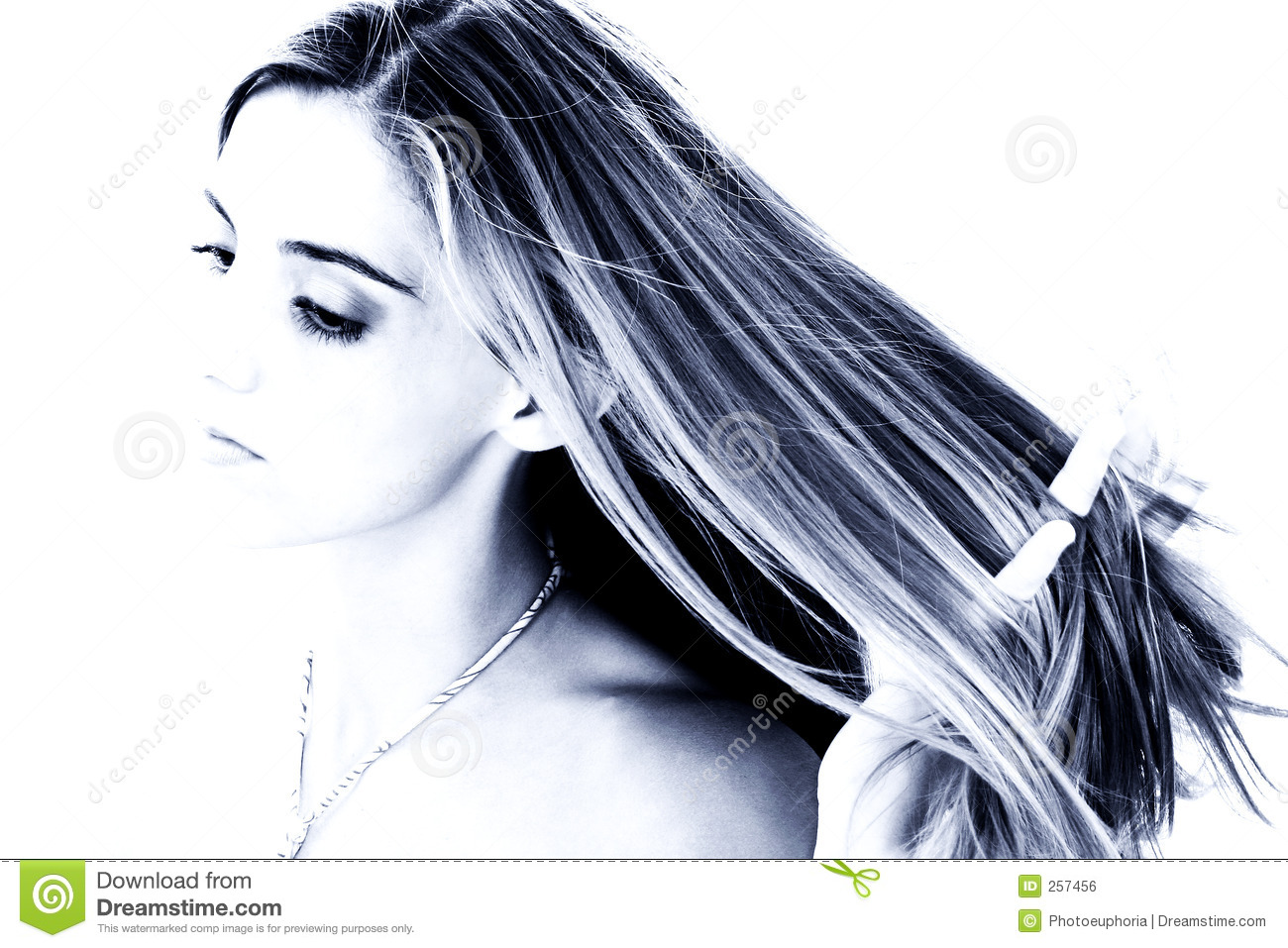 Beautiful Young Woman with Hands in Hair