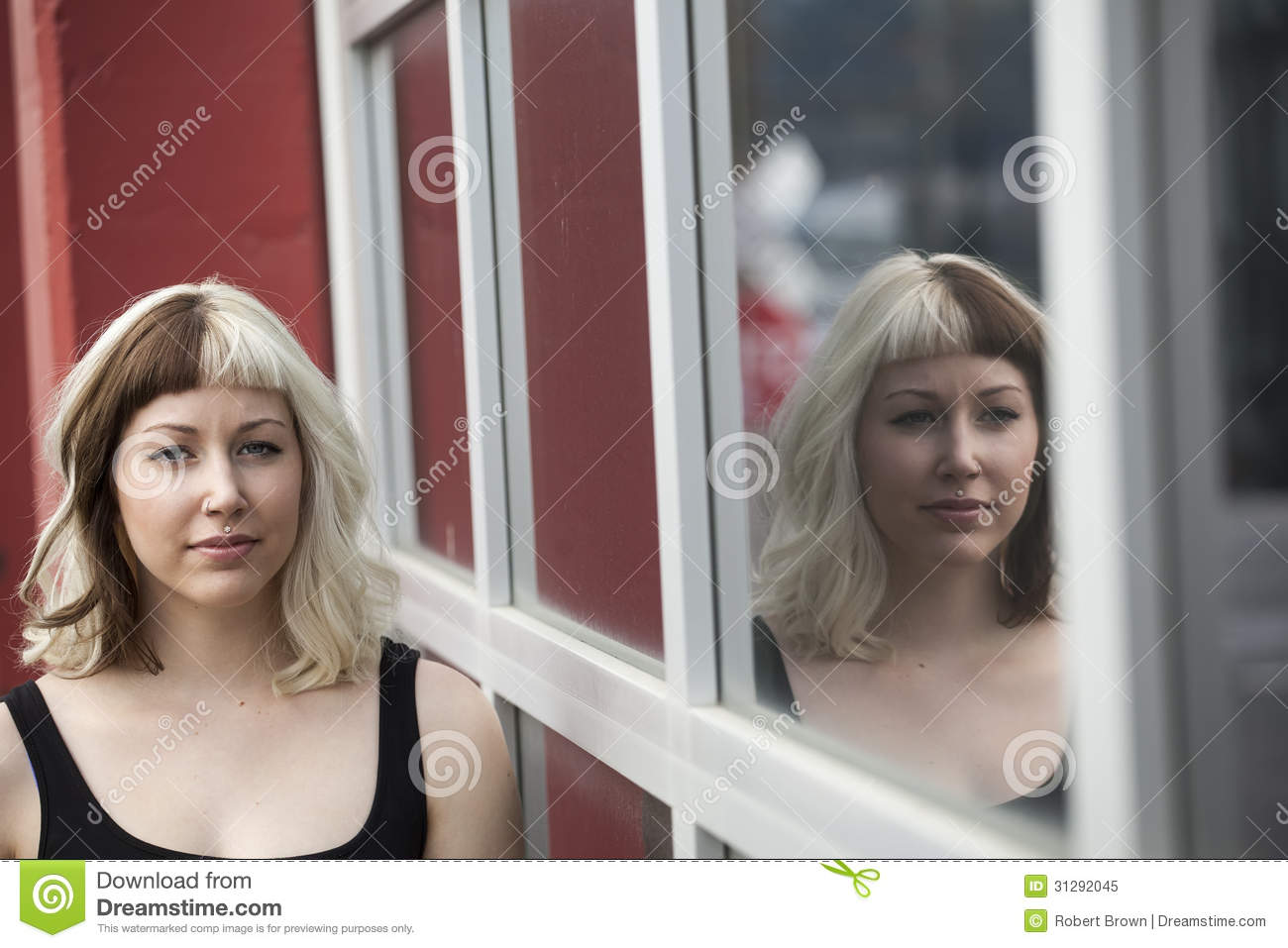 Beautiful Young Woman with Her Reflection