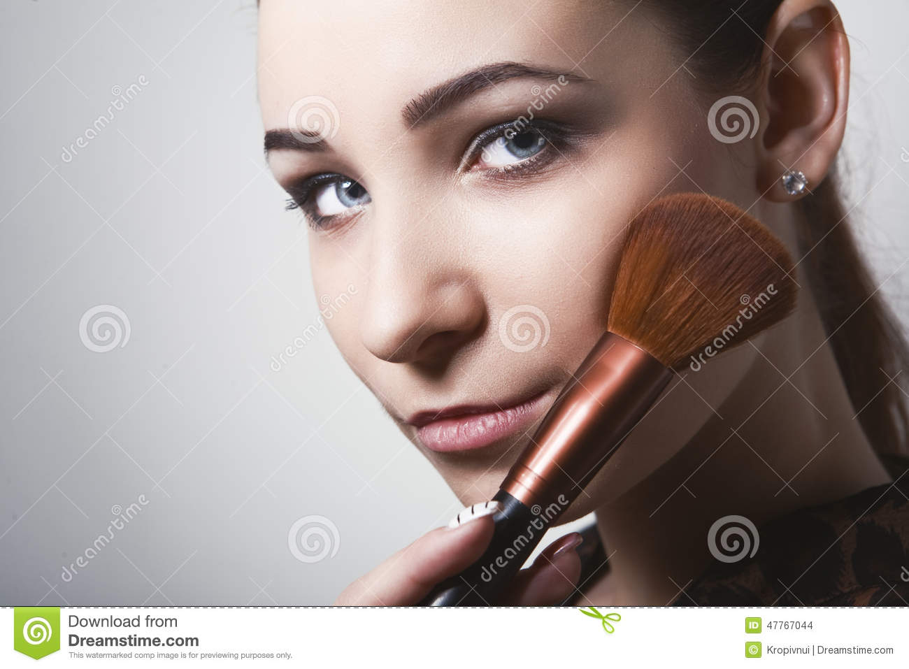 Beautiful Girl Holding Fashion Beauty Magazine Stock Image: Beautiful Young Woman Holding Different Make-up Brushes