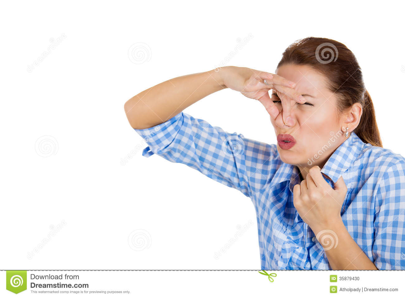 A Beautiful Young Woman Holding Her Nose To Avoid The Bad