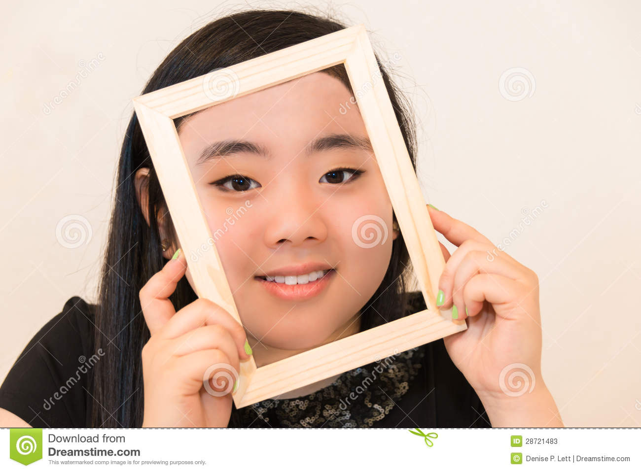 Beautiful Young Woman Holding Picture Frame