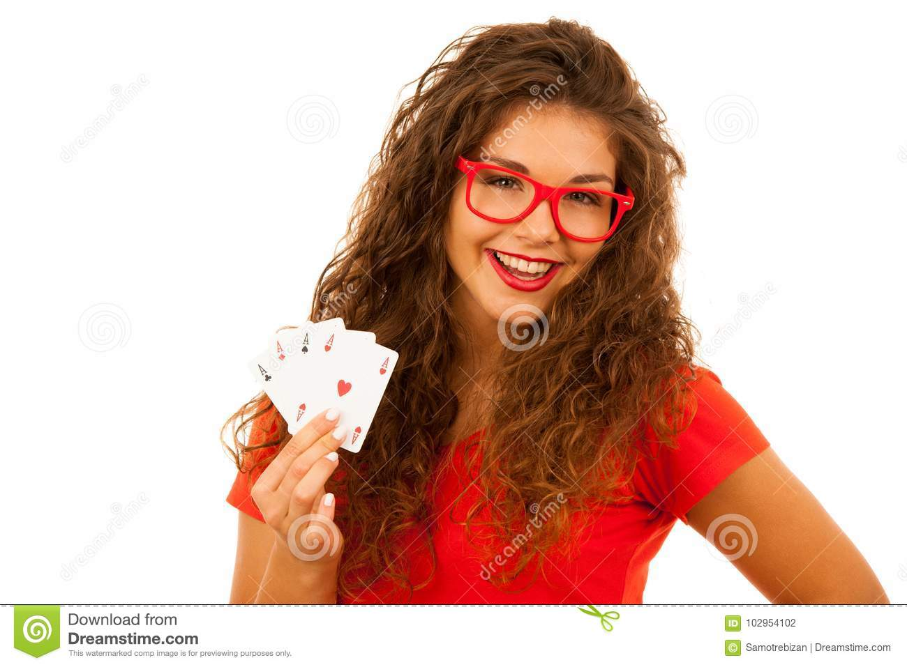 Beautiful young woman holds poker cards four aces isolated over