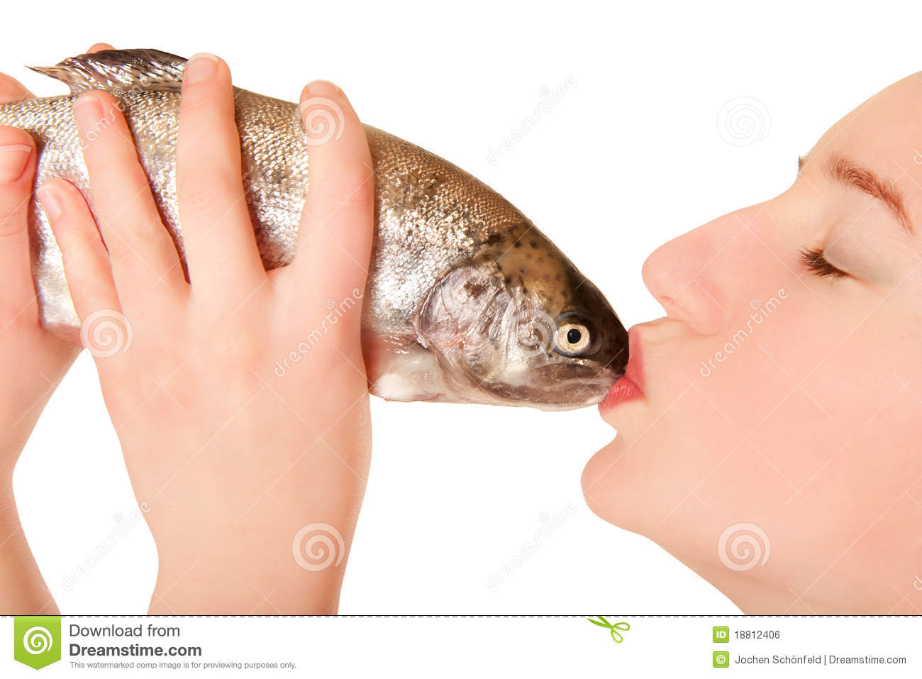beautiful young woman kissing a fish royalty free stock