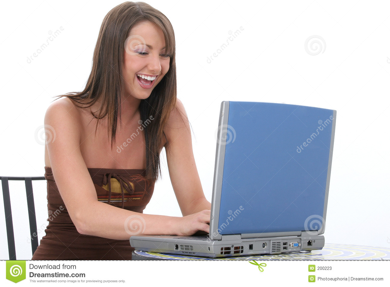 Beautiful Young Woman with Laptop Computer Laughing