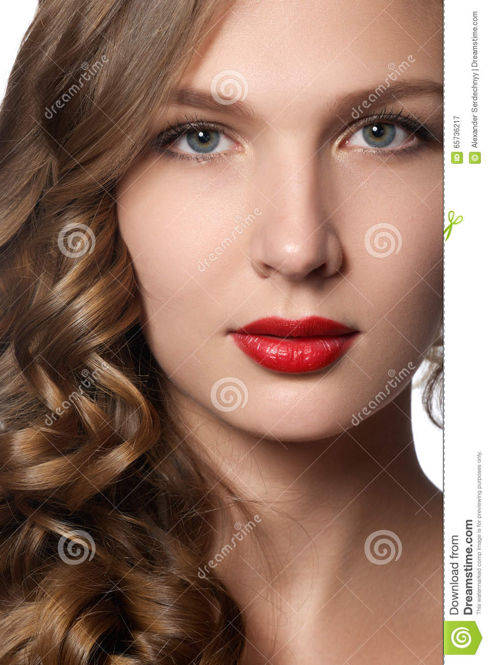 Beautiful young woman with long curly hair. Beautiful model with long curly brown hair. Lovely model with shiny volume curly hair