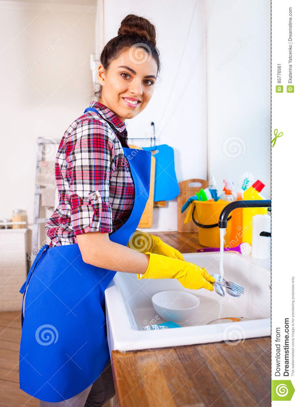 beautiful young woman makes cleaning the house. girl cleaning ki