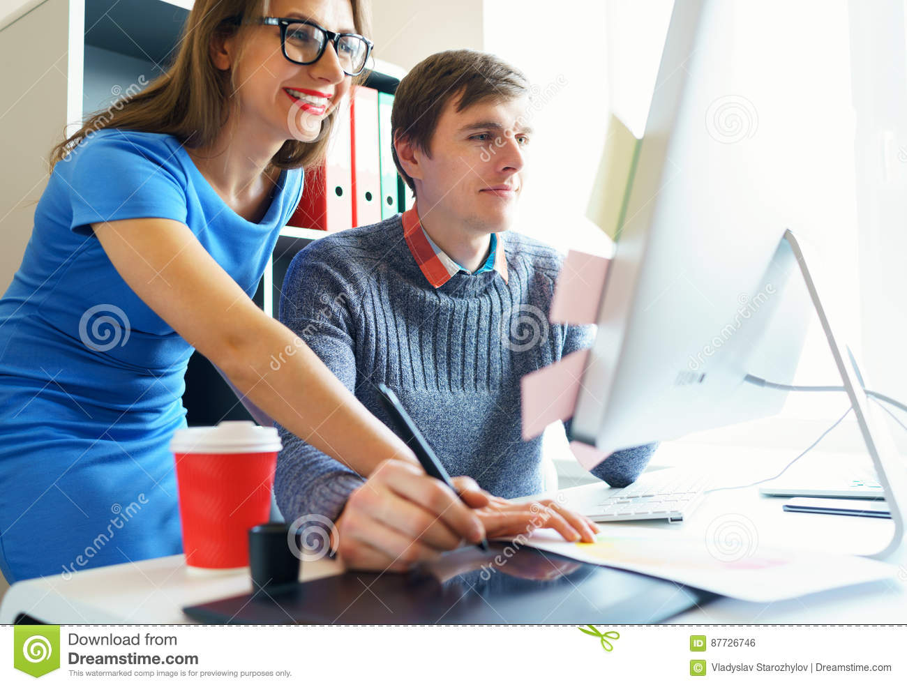 Beautiful young woman and man working from home office