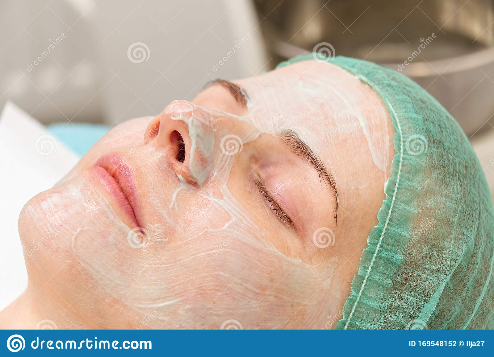 Beautiful Young Woman With Natural Moisturizing Mask On The Face