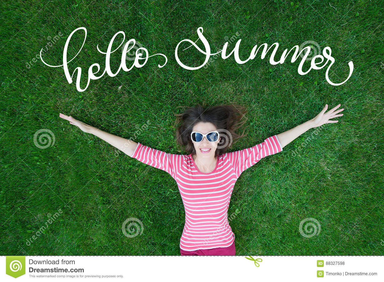 Beautiful Young Woman Outdoors in Green Grass and text Hello Summer. Calligraphy lettering