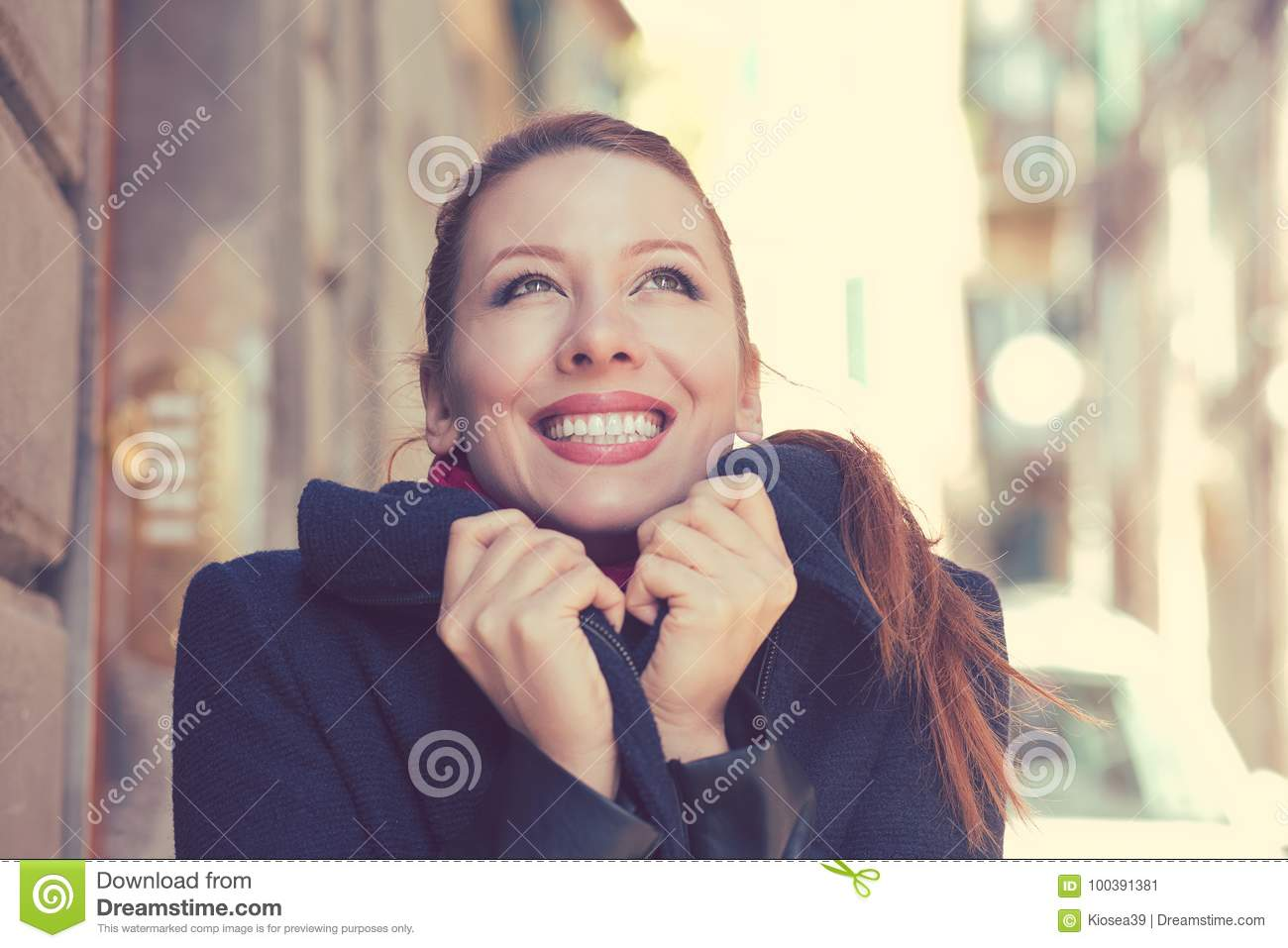 Beautiful woman with perfect white smile feeling happy and warm on a sunny autumn day