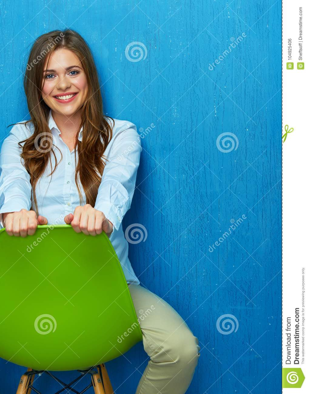 Beautiful young woman portrait sitting on chair.