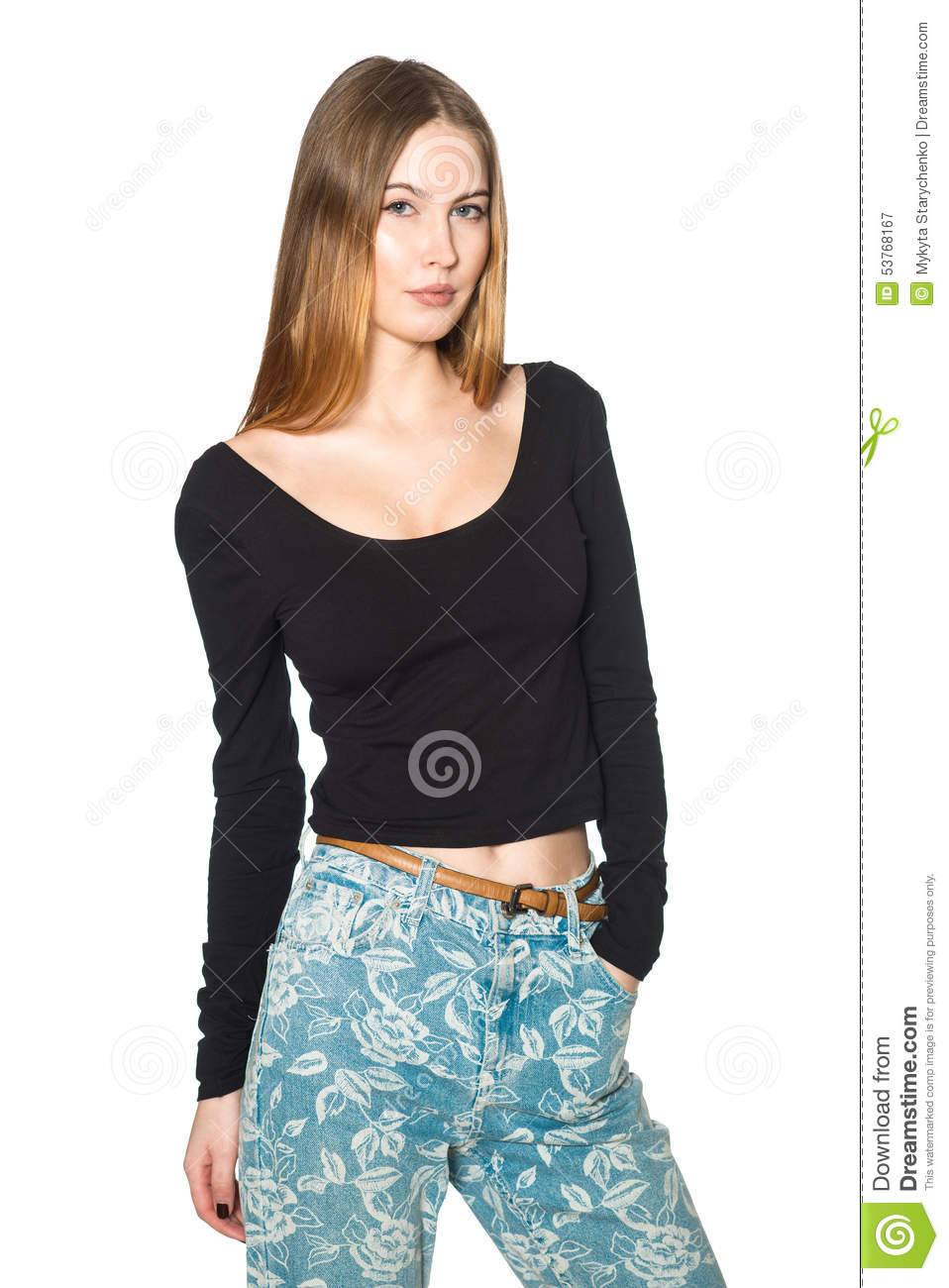 Black t shirt and jeans - Beautiful Young Woman Posing Wearing Black T Shirt And Jeans Stock Photo