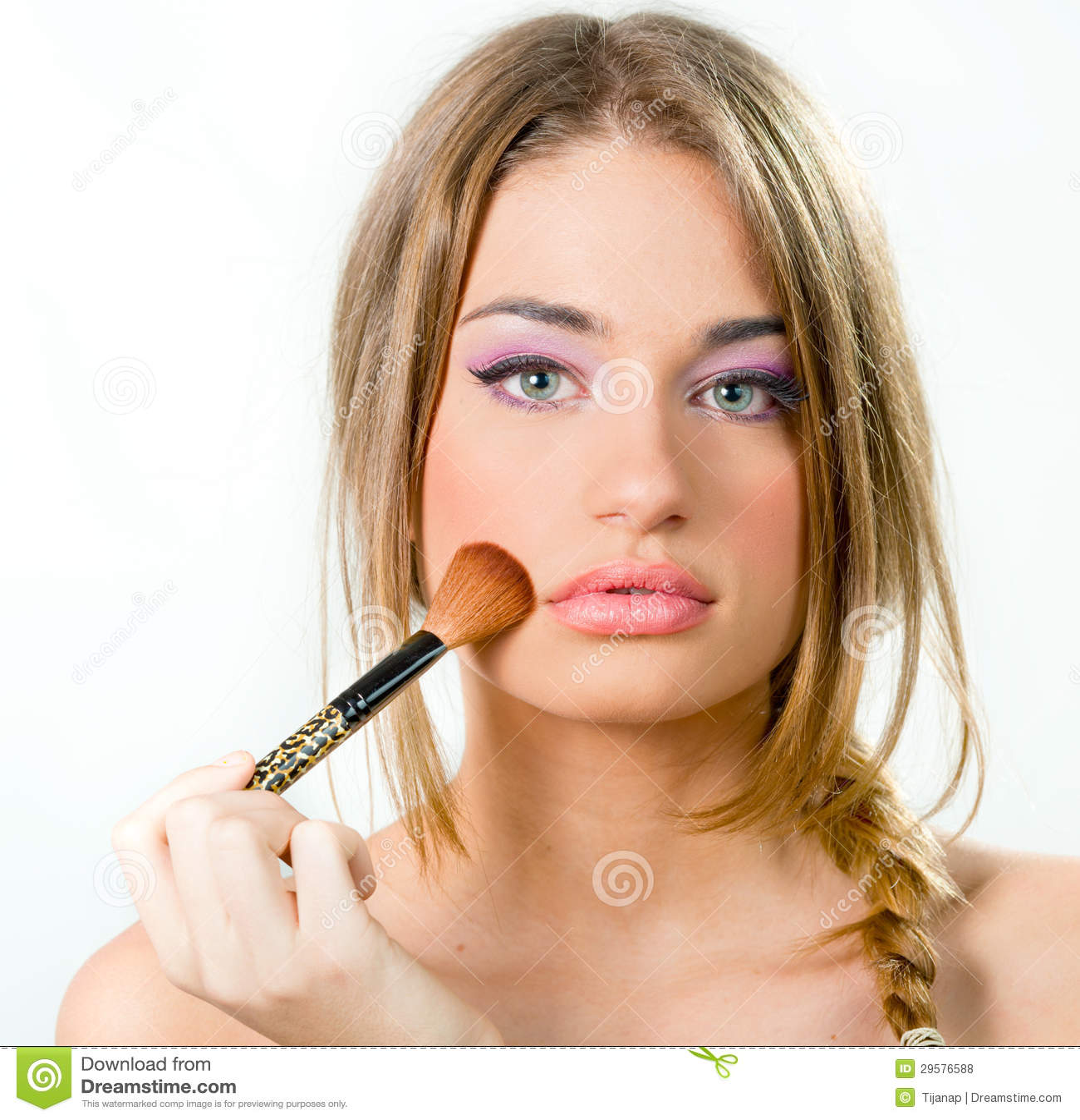 nude woman putting on makeup