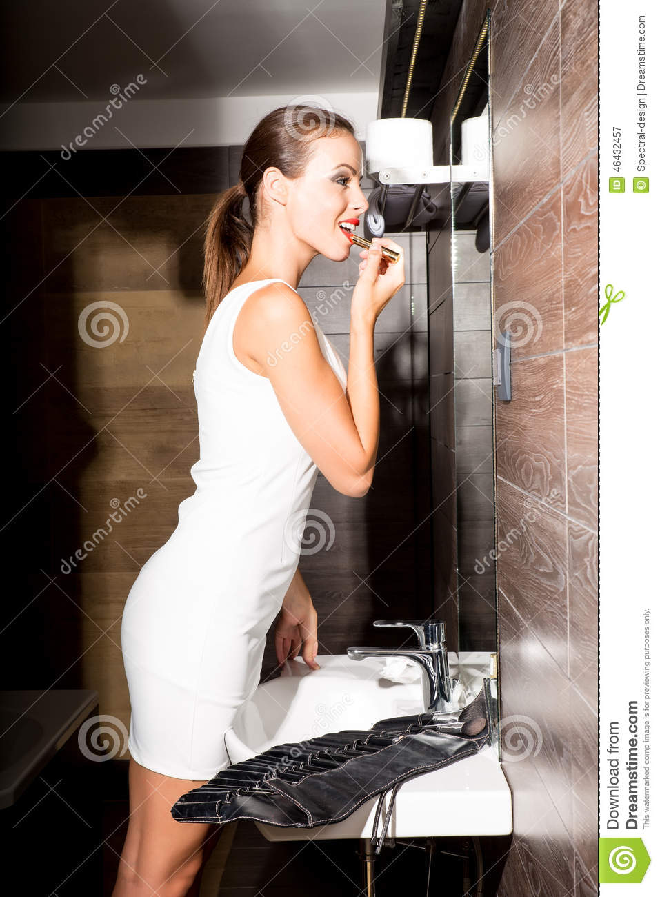 Beautiful Young Woman Putting On Makeup In The Bathroom Stock Image Image 46432457