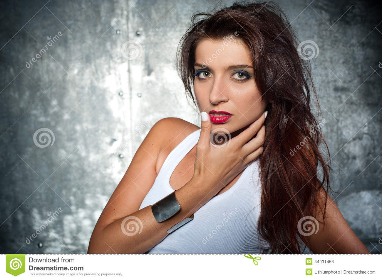 Beautiful young woman in a rock style
