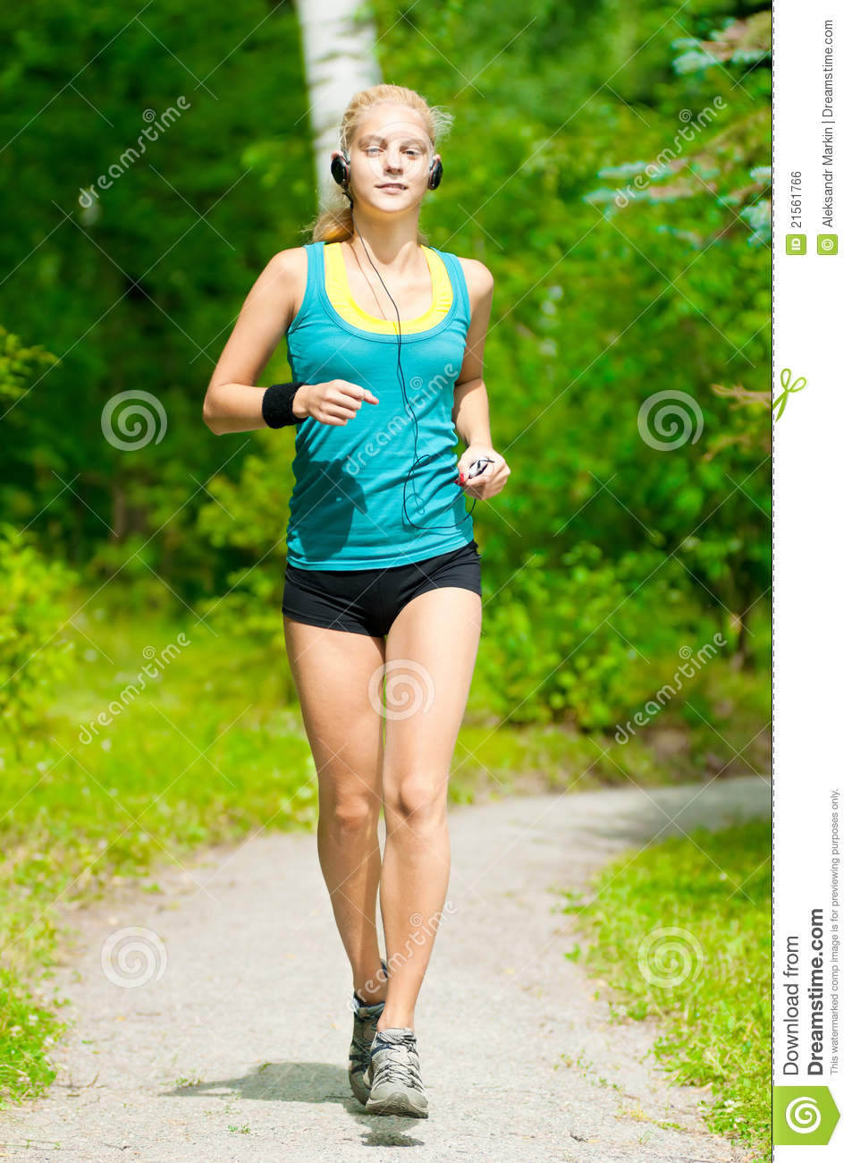 beautiful young woman running on music royalty free stock