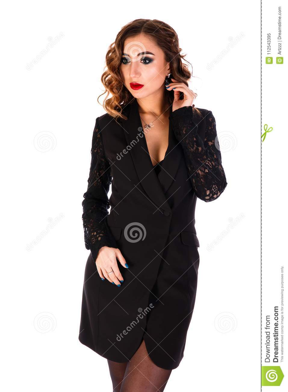7ce586d678b5 Beautiful young woman in a short black dress isolated over white background