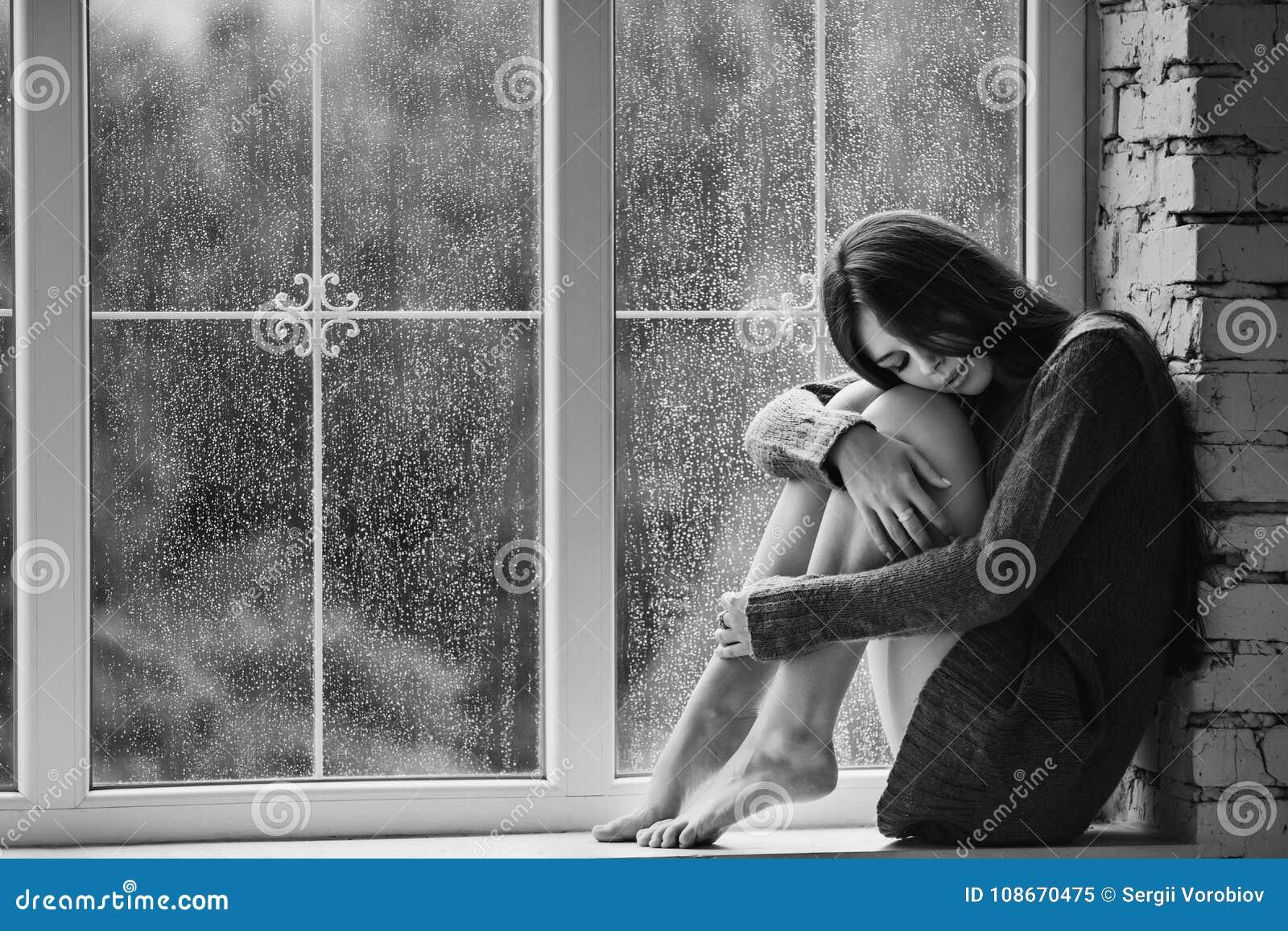 Beautiful Young Woman Sitting Alone Near Window With Rain ...