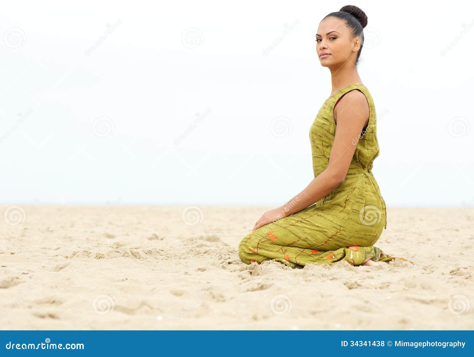 Beautiful Young Woman Enjoying Sun On A Sand Beach Stock