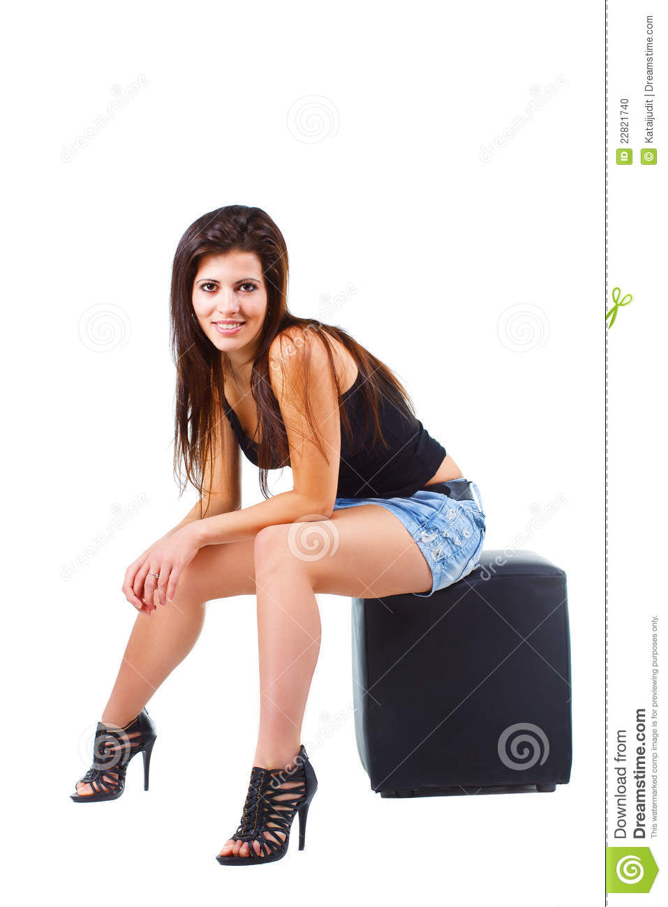 Innovative  Haired Cheerful Girl In A Short Skirt Sitting On A Chair And Gesturing