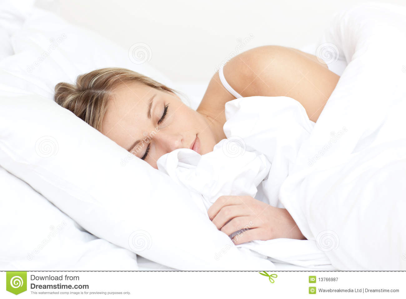 Beautiful young woman sleeping on her bed royalty free The more pillows you sleep with