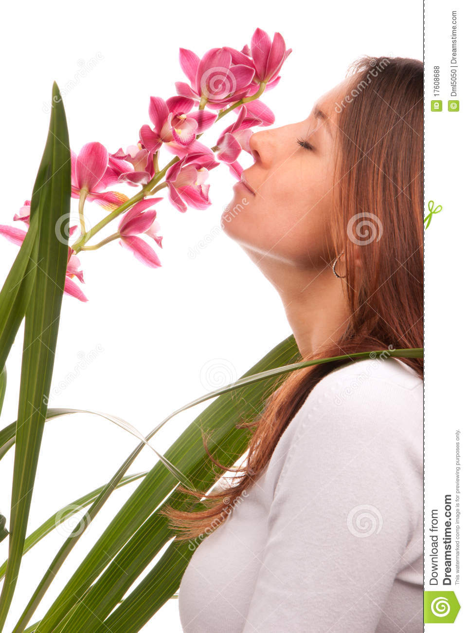 Beautiful Young Woman Smelling Orchid Flower Stock