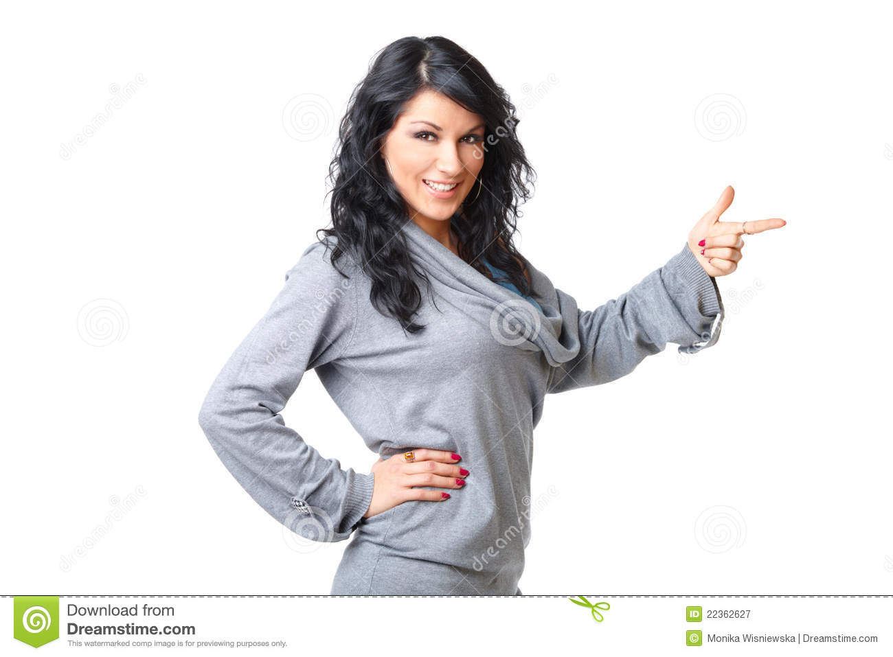 Beautiful young woman standing and pointing