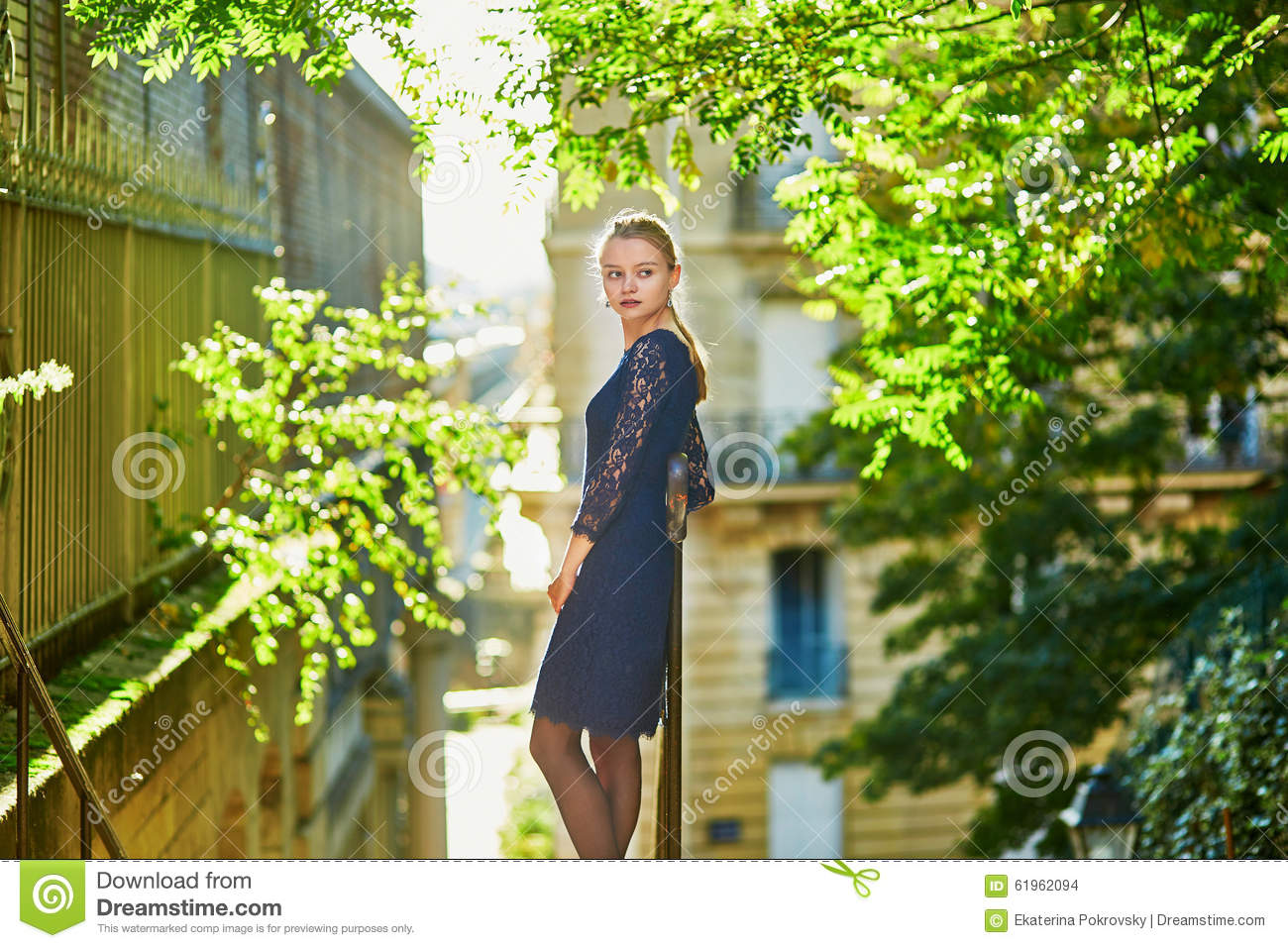 Beautiful young woman on a street of Paris