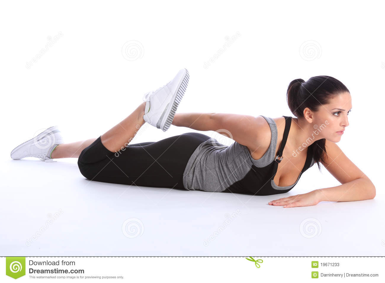 Beautiful young woman stretch exercising on floor stock for Floor workout