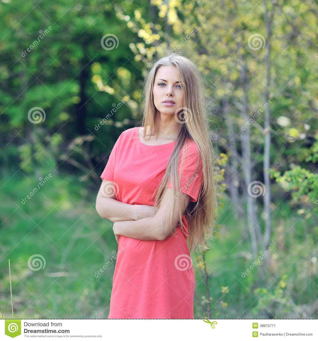 Portrait Of Beautiful Young Woman Posing On Sunny Day