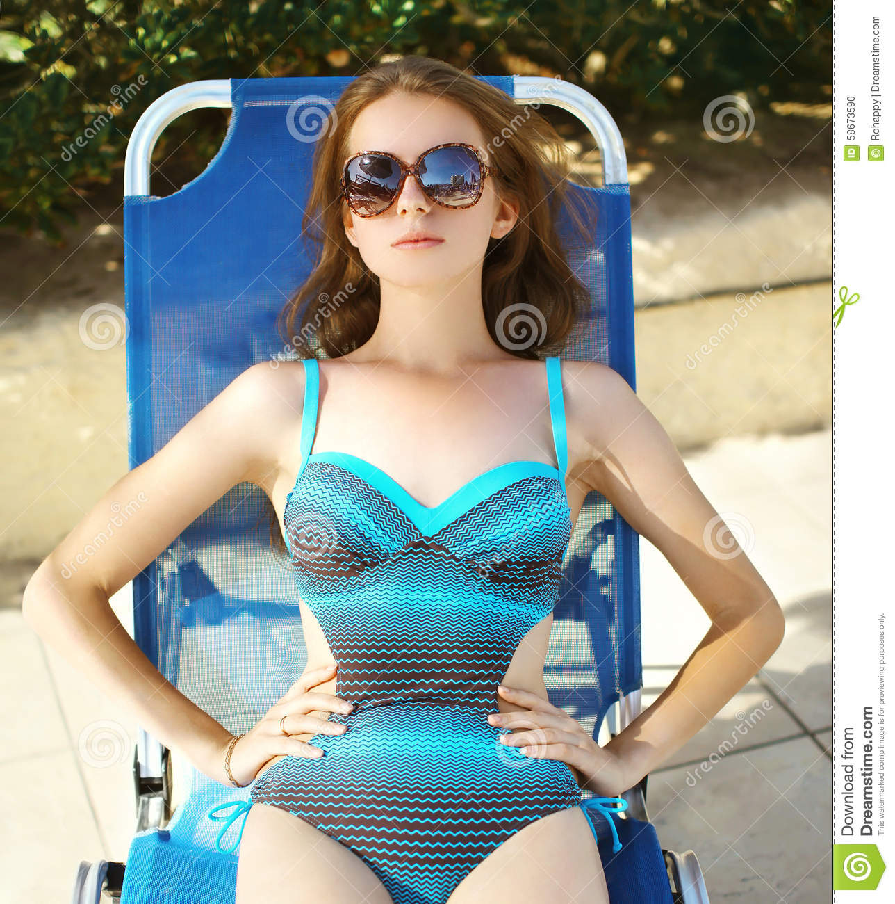 Beautiful Young Woman In The Swimsuit Relaxing On Beach