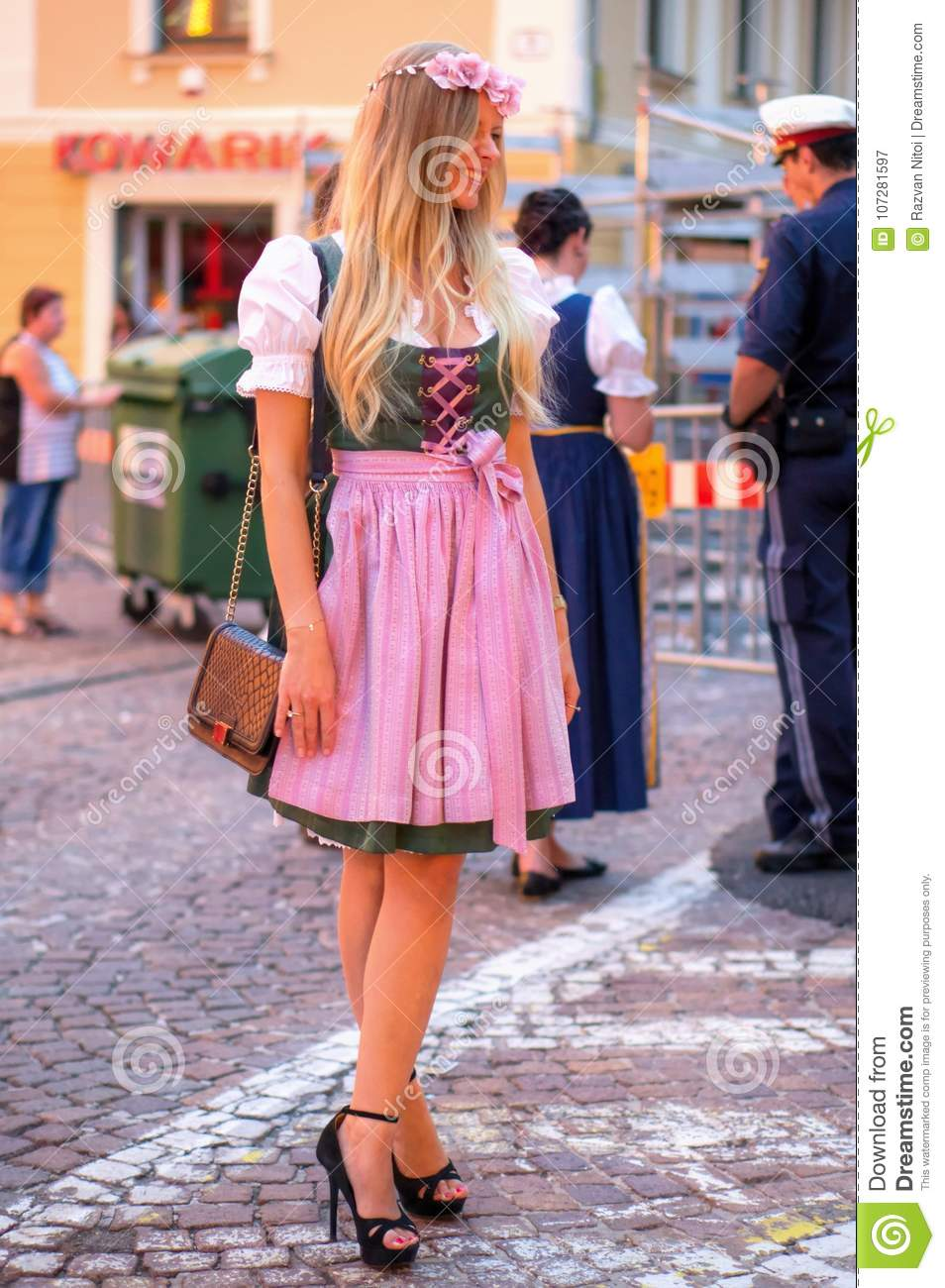 Beautiful young woman in traditional Austrian costume