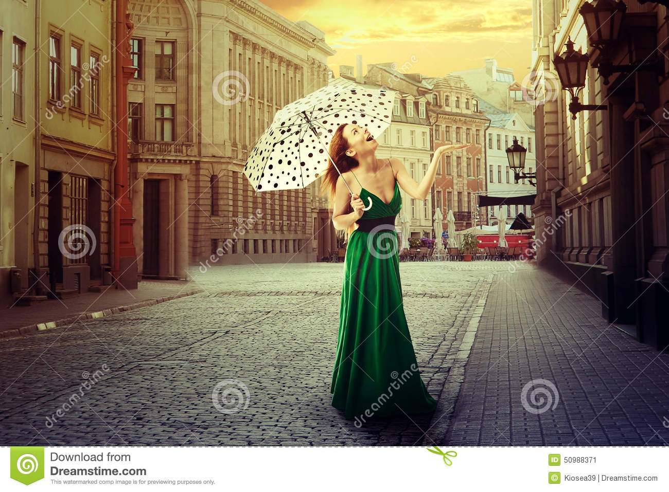 Beautiful young woman with umbrella in an old street town